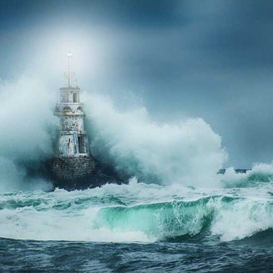 lighthouse covered in waves
